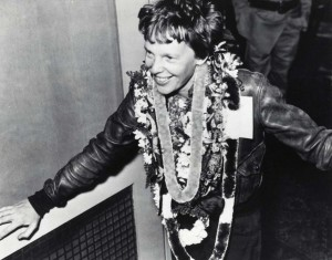 Amelia Earhart wears lei upon arrival from Oakland, California, March 18, 1937 in 15 hours 47 minutes. She set a speed record for that route with four hours of fuel remaining.